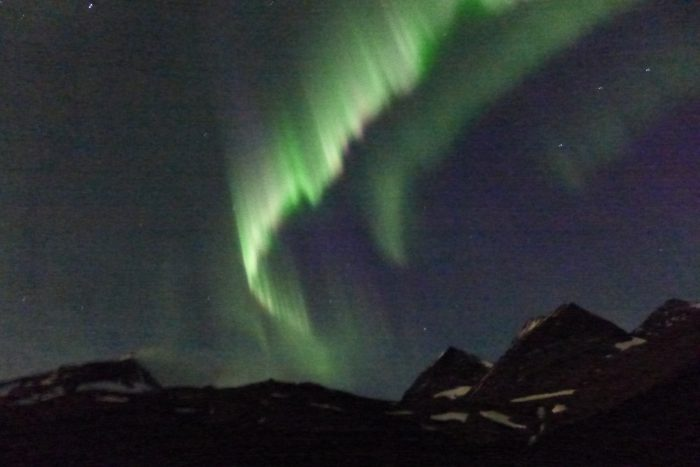 Aurora borealis appearing over Nallostugan
